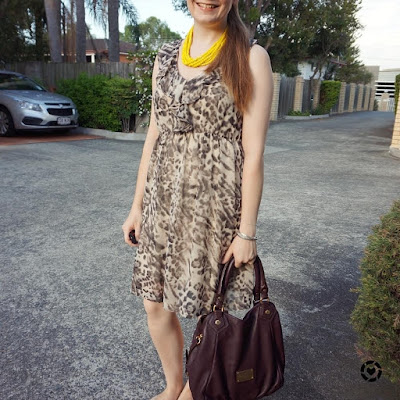awayfromtheblue instagram | animal print dress in office with statement neckalce marc jacobs carrob brown fran bag
