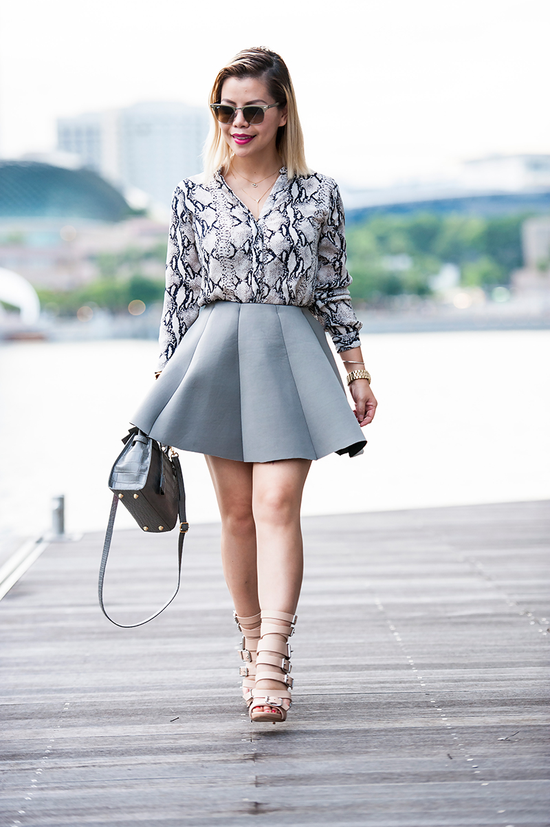 Crystal Phuong- Grey snakeskin blouse and grey skirt