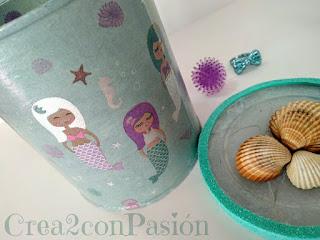 Lata-reciclada-con-decoupage-de-sirenas-brillantes-y-conchas-Crea2-con-Pasión