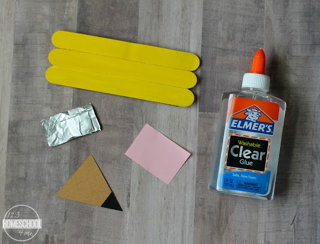 cut out the eraser from pink construction paper, tip should be brown consturction paper in a triangle,