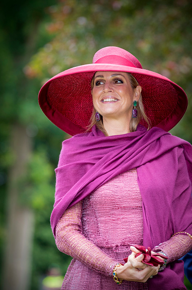 Queen Maxima wear a bright purple wide brimmed hat as she attends the Dutch  Rose Association s National Symposium in the Rosarium on June 13 df6dc6bbf3d0