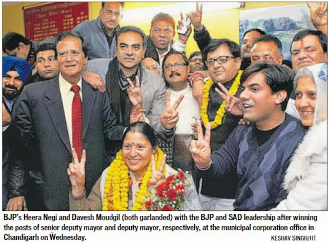BJP's Heera Negi and Davesh Moudgil (both garlanded) with the BJP and SAD leadership after winning the post of Senior Deputy Mayor and Deputy Mayor, respectively, at the Municipal Corporation office in Chandigarh on Wednesday.