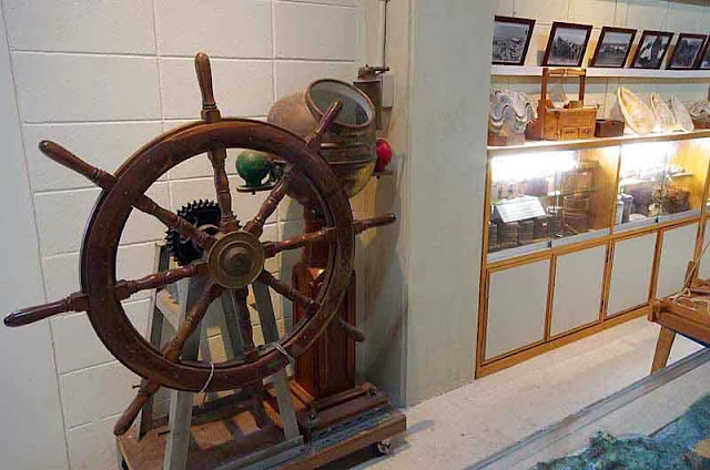 ship's wheel and srtifacts in fishing museum