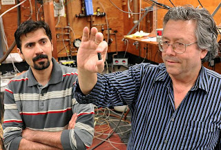 SFU physicist Mike Thewalt and grad student Kamyar Saeedi with a sample of highly isotopically enriched silicon - its unique properties could advance quantum computing. (Credit: Image courtesy of Simon Fraser University)