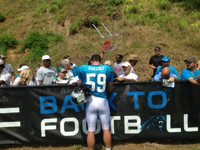 3510c8fc6 Luke Kuechly signs autographs for fans Tuesday in Spartanburg after  practice. After spending much of Monday and Tuesday watching the Panthers  ...