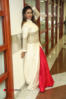 Telugu Actress Sri Reddy Mallidi Stills in White Beautiful Dress at Marriage Needs Bridal Fashion Week 2017 Logo Launch  0038.JPG
