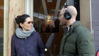 Josh Bloch interviews Sarah Edmondson in front of the former site of Vancouver's Executive Success Programs (ESP) centre in February 2018. (Kathleen Goldhar/CBC)