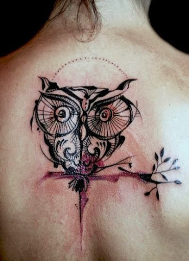 unique owl tattoo on back