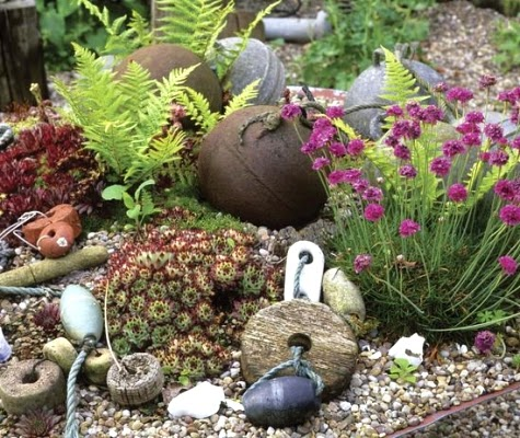 decorate planting beds with beach finds