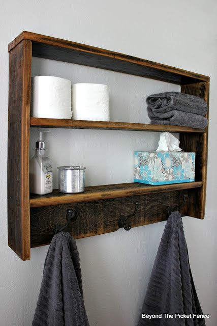 an easy to build rustic wall shelf made from fence boards