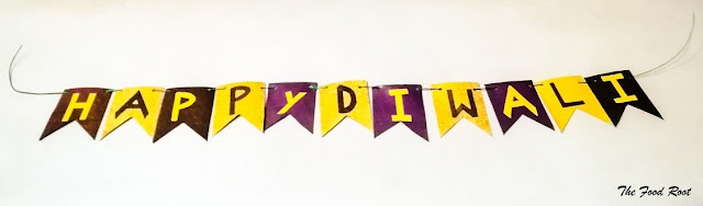 Festive banners are very easy to make. Cut them in whatever shape you like. Either write it with a marker or make the letters and stick them on the flags. Punch them in the corners of the flags and hang them with the help of a twine.