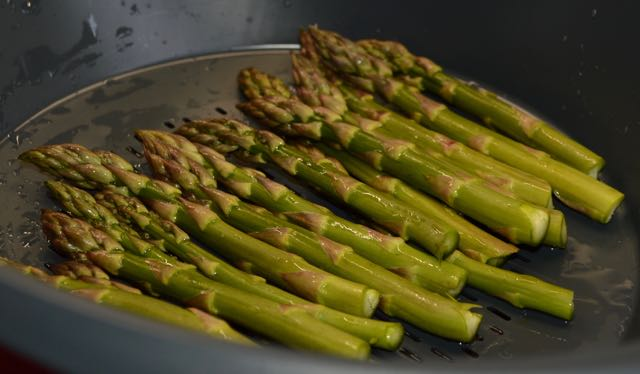 Asparagus being steamed in the Varoma