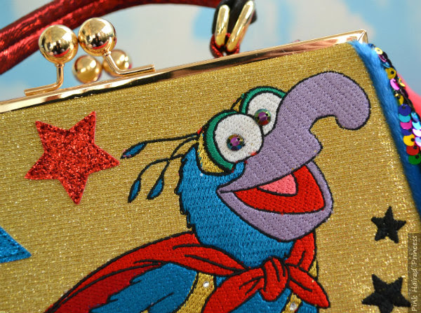 beaded eyes and Gonzo embroidered face on handbag