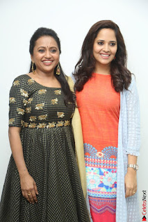 Actress Suma in Black Salwar Suit and Anusuya in orange Dress at winner movie press meet part 1 February 2017 (57).JPG
