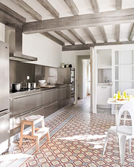 Kitchen with inox cabinetry and patterned cement floor tiles