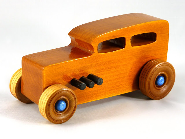 Left Front - Wooden Toy Car - Hot Rod Freaky Ford - 32 Sedan - Pine - Amber Shellac - Black Pipes - Metallic Blue Hubs