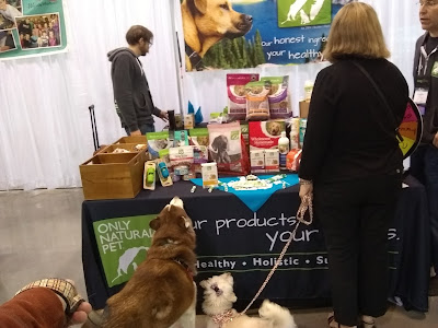 At the BlogPaws conference, visiting the Only Natural Pet booth.  They offer all natural pet products.  Natural Dog food, Pet supplements, Dog treats and other natural products for pets