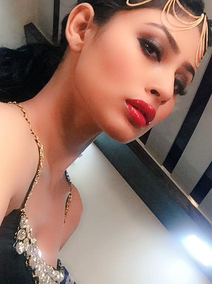 Mouni Roy hot actress poses in red poses