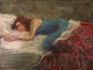 a girl sleeping on her stomach and is covered with red and blue quilt