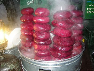 Peeled, steaming-hot, boiled beets, neatly stacked according to size, never fail to allure the travelers.
