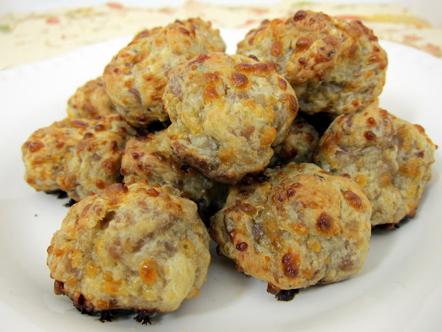 Boursin Cream Cheese Sausage Balls - tons of great flavor!  Italian sausage, boursin cheese, mozzarella, cream cheese and Bisquick. Can make ahead and freeze balls for a quick snack/appetizer later!! #sausageballs #appetizer #freezermeal