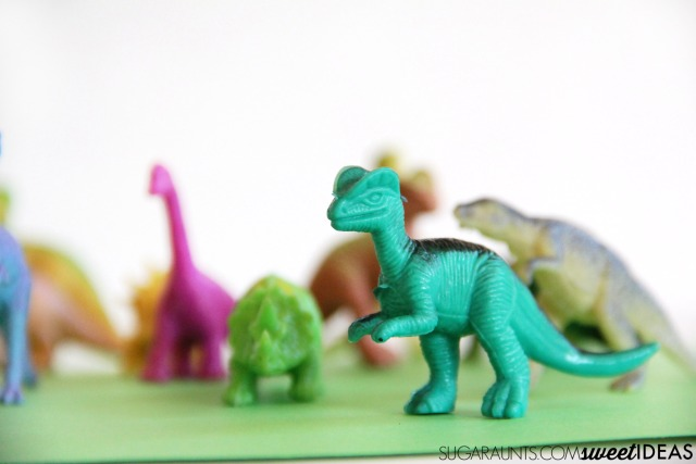 Use plastic dinosaurs in this Goldilocks and the Three DInosaurs jacks game based on Mo Willems childrens book.