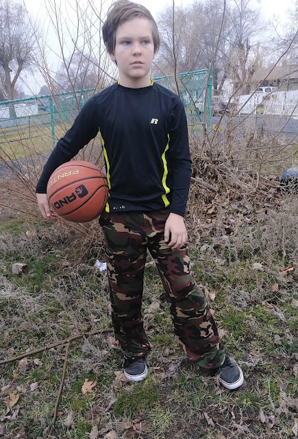 Boy in camo pants with basketball