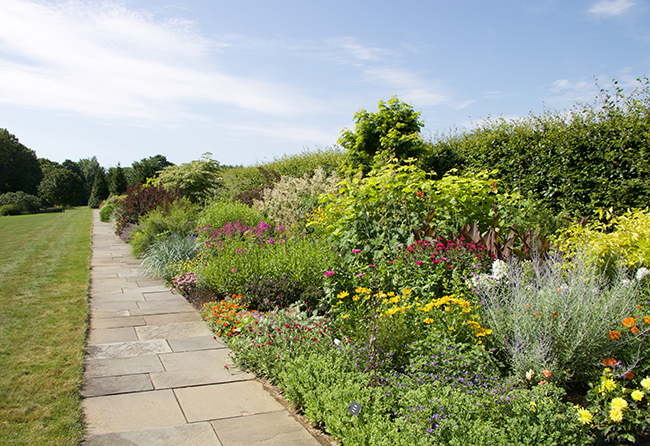 Growing with plants a summer visit to connecticuts white flower perhaps the greatest feature at white flower farm is a rather new one a massive perennial border in the british style designed by christopher lloyd on mightylinksfo