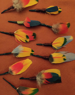 Colored feathers as boutonnieres