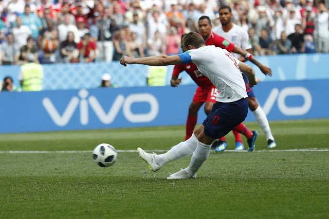 Harry Kane striking the ball perfectly to score England's penalty vs Panama