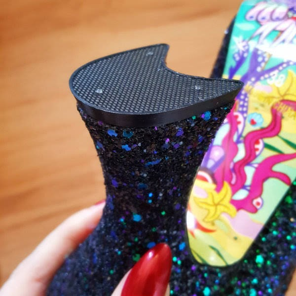 close up of curved heel on boot
