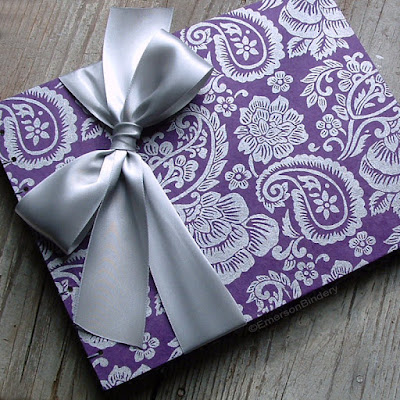 silver paisley on purple handmade guest book by Emerson Bindery