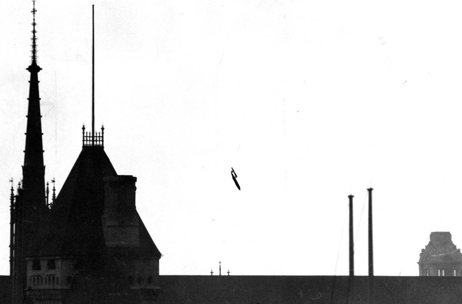 "A V-1, ""buzz bomb"", plunging toward central London, 1945."