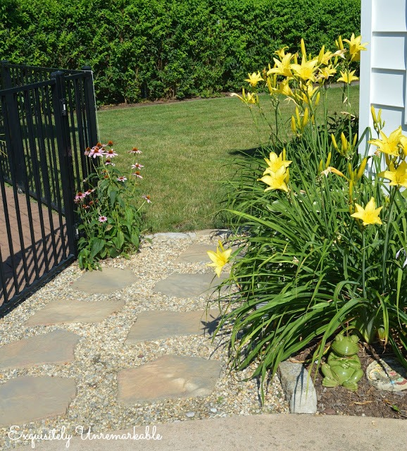 Garden Path with large stones and pebbles with plants on each side
