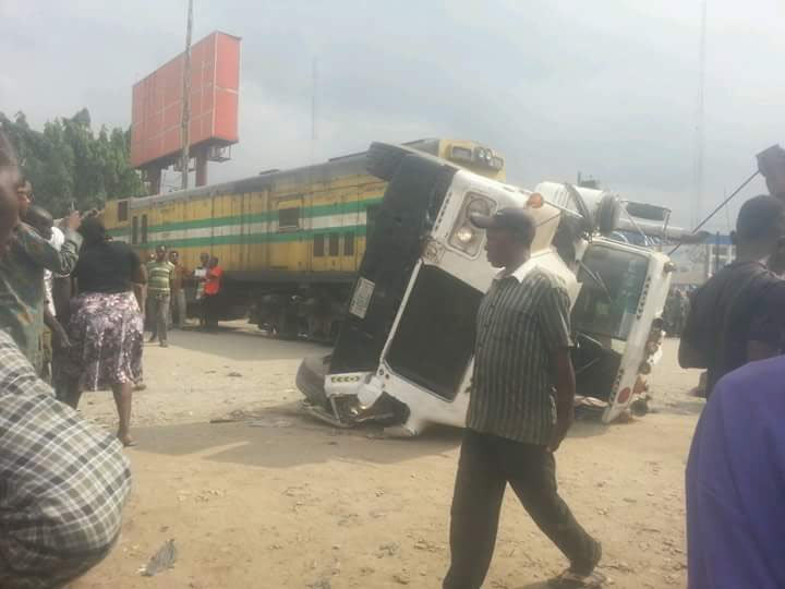 Photos, Video: Chaos as train collides with trailer in Aba