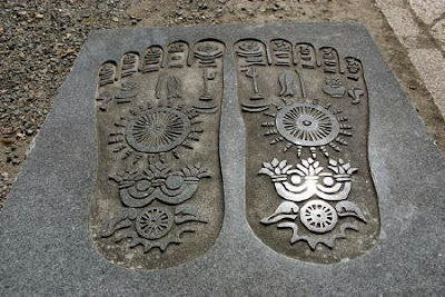 Bussokuseki footprints of Buddha engraved in stone