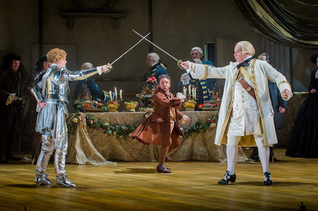 Der Rosenkavalier - Opera North - Helen Sherman as Octavian, Mark Burghagen as Leopold and Henry Waddington as Baron Ochs. Photo Credit: Robert Workman