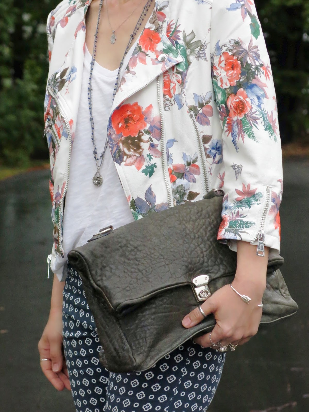 styling printed skinny pants with a white t-shirt and floral moto jacket