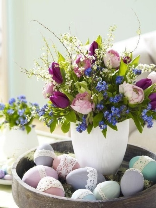 pastel Easter decoration with flowers and lace decorated eggs