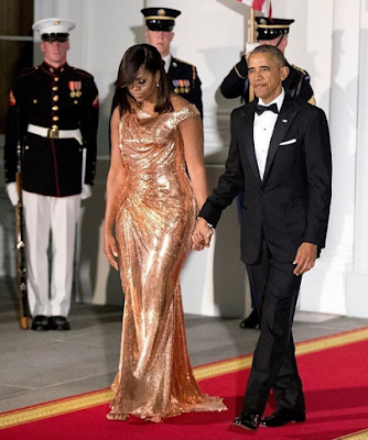 Image result for Michelle Obama dazzles in gold for the Obamas final state dinner(Photos)
