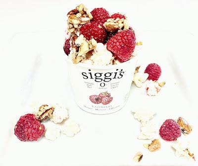 Siggis Raspberry Yogurt with fresh Raspberries, KIND Snacks Nutrition Bar and Jolly Time Popcorn