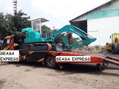 trucking alat berat