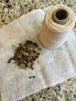 Photo of a square of cheese cloth, pickling spice, and cotton kitchen twine which will be tied up into a bag to season hot sauce ingredients. https://trimazing.com/