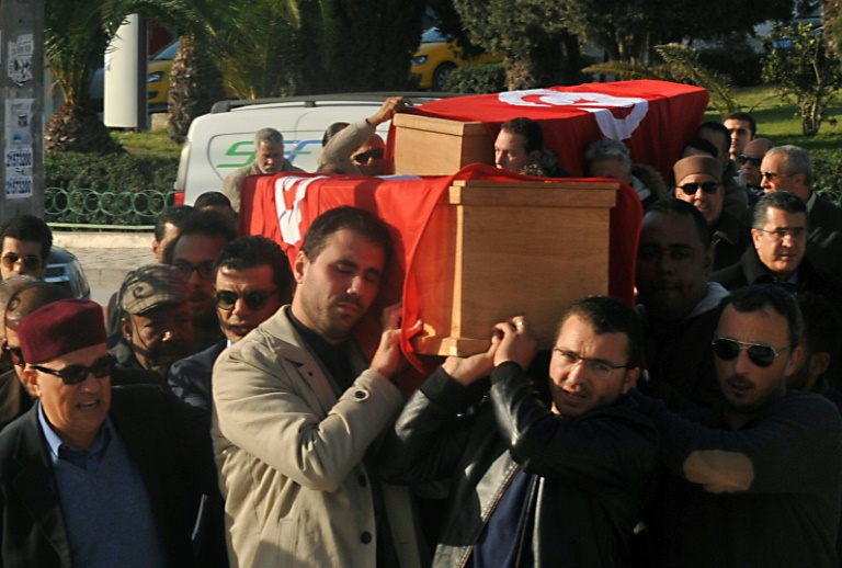 Relatives and friends carry the coffins of husband and wife Mohamed Azzabi and Senda Nakaa, killed in an Istanbul nightclub shooting on New Year's Eve that left 39 dead.
