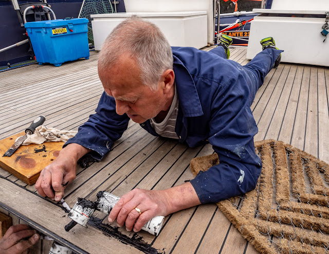 Photo of Phil replacing the caulking that Ruby pulled out