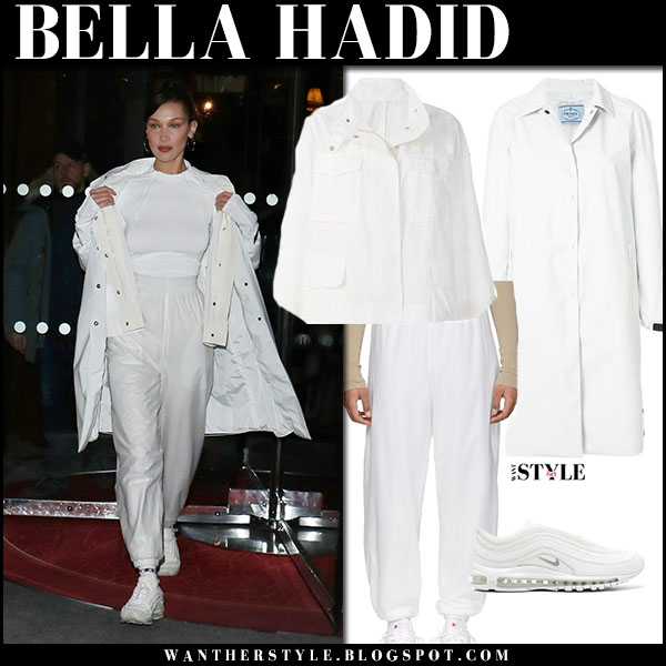 Bella Hadid in white prada coat, white moncler jacket and white sweatpants street style paris february 27