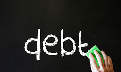 4 Reasons Why Debt Affects a Relationship Negatively board writings black and whote erase words