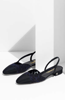 http://www.chanel.com/en_US/fashion/products/shoes/g/s.slingbacks-lace-grosgrain-navy.17C.G31319Y51039C9649.cat.pum.html