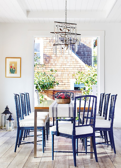 Blue dining area photographed by Brad Knipstein.