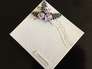 hand made birthday card with embossed and die cut background and lilac paper roses